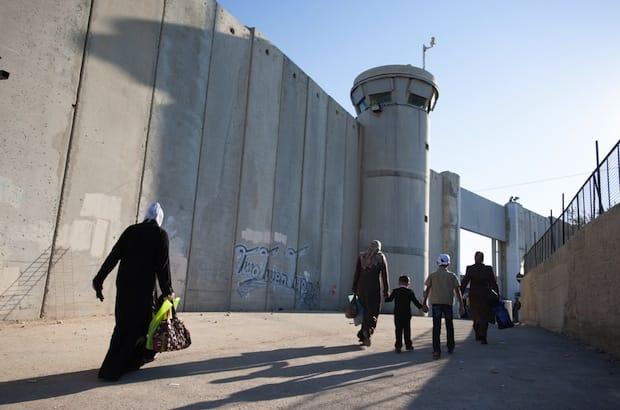 Palestinian women and children pass through the Bethlehem checkpoint in August 2012. Photo: Ryan Rodrick Beiler/Shutterstock