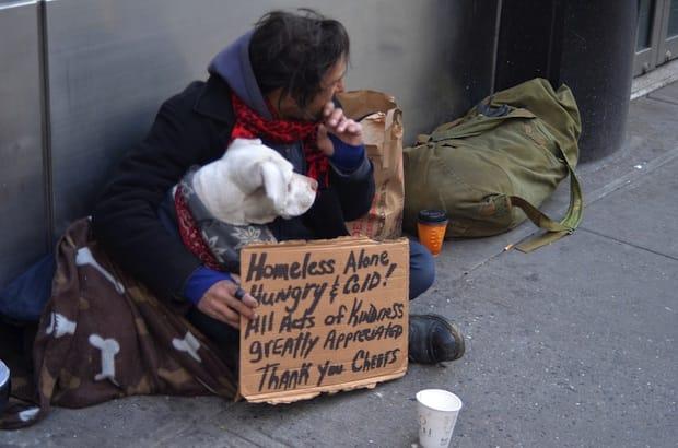 A homeless man seeks help. Photo: Anton Oparin/Shutterstock