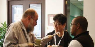 Michael Lapsley chats with Nak-Hyon Joo of Korea and Lapsley's personal assistant, Mosuoe Rakuoane. Photo: Harvey Shepherd