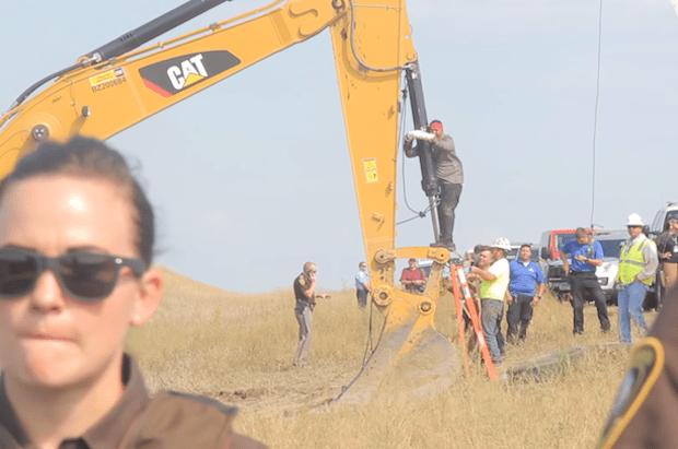 "Anti-Dakota Access Pipeline ""water protectors"" lock themselves to construction equipment at Standing Rock. Photo: Desiree Kane/Wikimedia Commons"