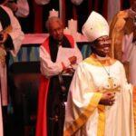 Bishop Jennifer Baskerville-Burrows greets the congregation at her consecration as Bishop Barbara Harris, centre, and Bishop Catherine Waynick, left, look on. Photo: Meghan McConnell