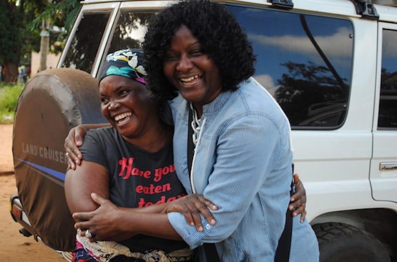 Joyce Mtauka (L)greetsZaida Bastos,PWRDF director of project relationships, in Ruponda village. Photo: André Forget
